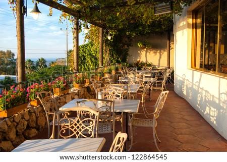 Romantic Mediterranean European style cafe bistro restaurant balcony with great view - stock photo