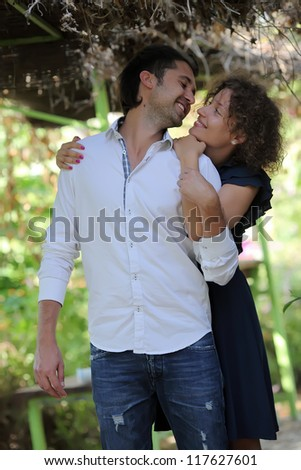 Romantic moments between a couple in the park - stock photo
