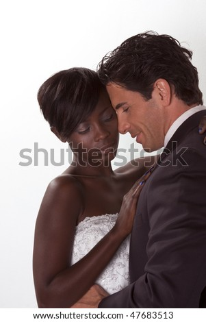 romantic newlywed young ethnic black African American woman and mid aged Caucasian man - stock photo