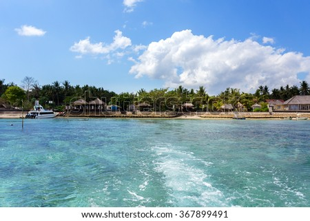romantic nusa penida beach, Bali Indonesia with blue sky, tranquil scene, view from ocean - stock photo