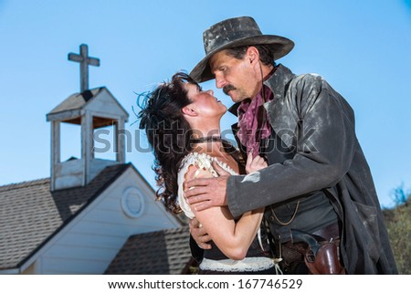 Romantic Old West Man and Woman Embrace - stock photo