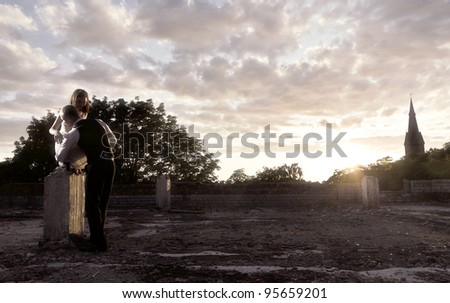 romantic pare on the roof - stock photo