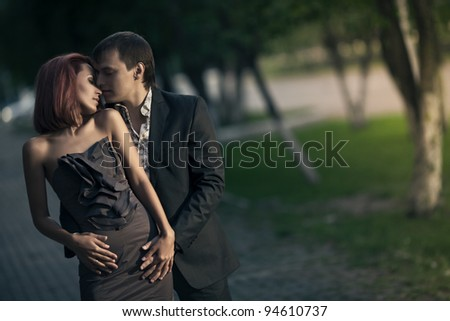 Romantic photo of a hugging couple - stock photo