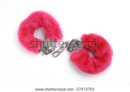 Romantic pink handcuffs isolated on white background - stock photo