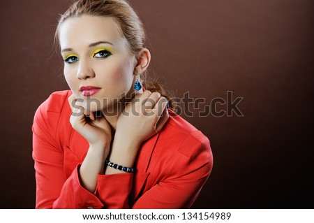 Romantic portrait of a beautiful girl on a brown background / sensual bare shoulders and neckline/colorful, spring makeup