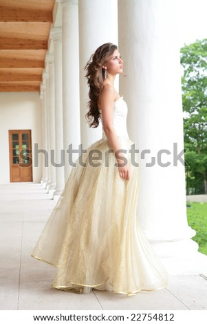 romantic portrait of the beautiful girl near pillars - stock photo