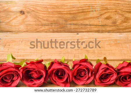 Romantic red roses flowers on a vintage wooden planks background for floral backgrounds, mothers day card, wedding invitation, greetings card, and invitation cards - stock photo