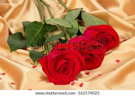 Romantic red roses on gold textile