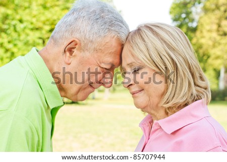 Romantic senior couple enjoying the moments together outdoors.