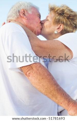 romantic senior couple kissing - stock photo