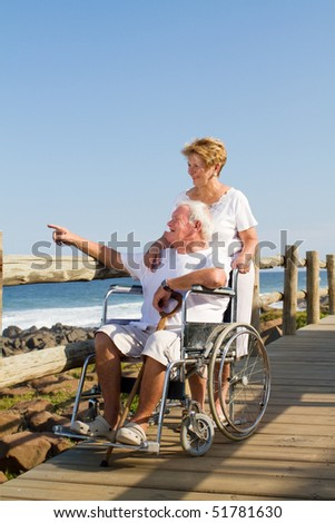 romantic senior couple on beach - stock photo