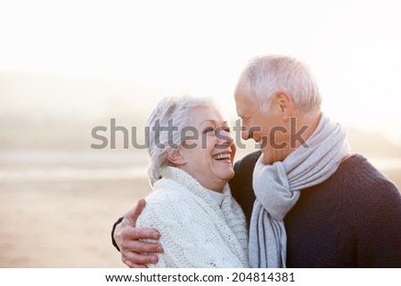 Romantic Senior Couple On Winter Beach - stock photo