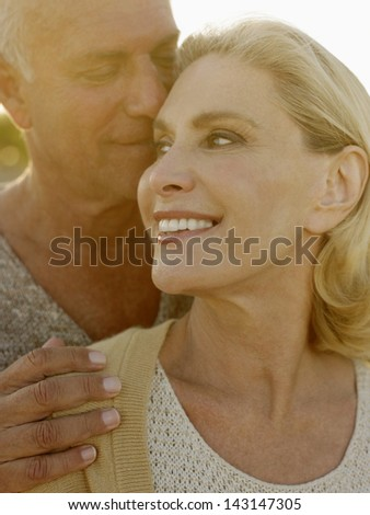 Romantic senior couple spending time together outdoors - stock photo