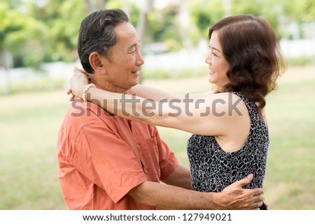 Romantic seniors embracing each other on a date - stock photo