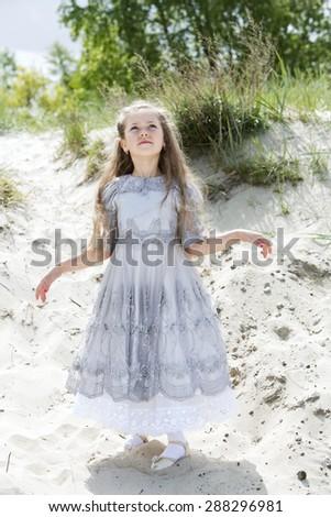 Romantic serious girl on the sunny beach - stock photo