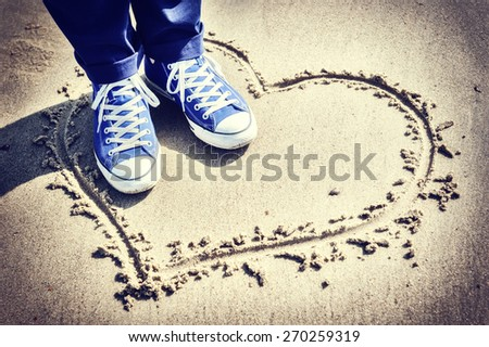 Romantic setting with heart sign on the beach  - stock photo