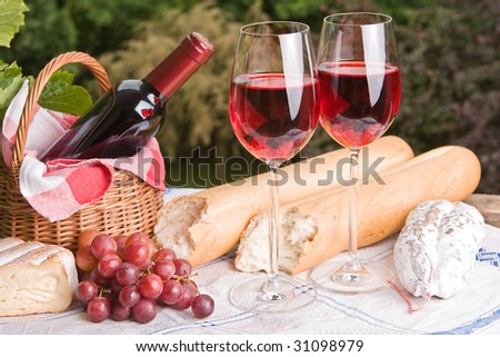 Romantic setting with wine and cheese for two - stock photo