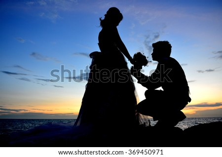 Romantic Silhouette of sunset wedding couple love on the beach and sea