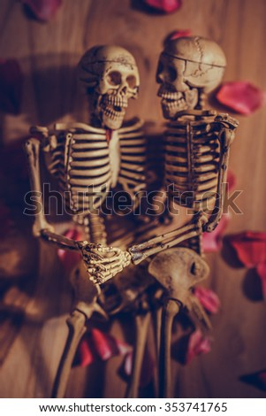 Romantic skeleton holding hand for eternal love. Selective focus on hand and finger. - stock photo