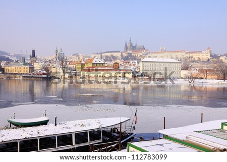 Romantic Snowy Prague gothic Castle above the River Vltava in the sunny Day, Czech Republic - stock photo