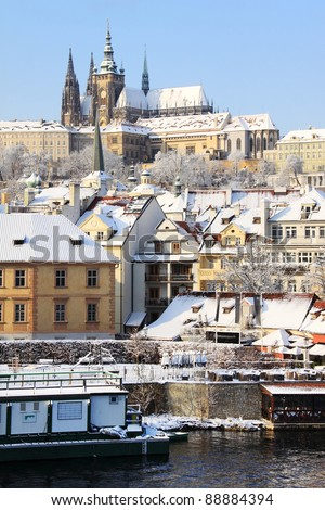 Romantic Snowy Prague gothic Castle in the sunny Day,  Czech Republic