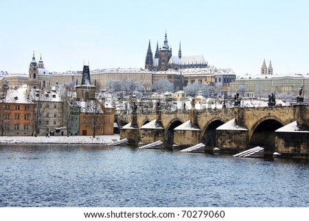 Romantic Snowy Prague gothic Castle with the Charles Bridge