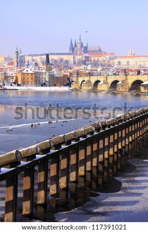 Romantic Snowy Prague gothic Castle with the Charles Bridge,  Czech Republic - stock photo