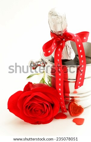 romantic still life champagne, roses, gifts for the holiday St. Valentine - stock photo