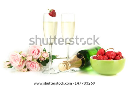 Romantic still life with champagne, strawberry and pink roses, isolated on white - stock photo