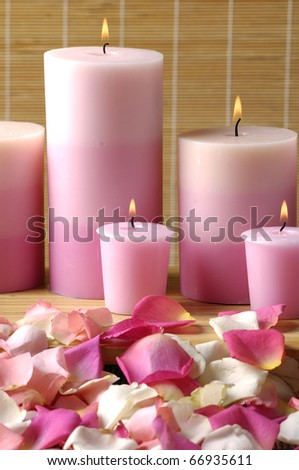 Romantic still-life with pink candle and rose petals - stock photo