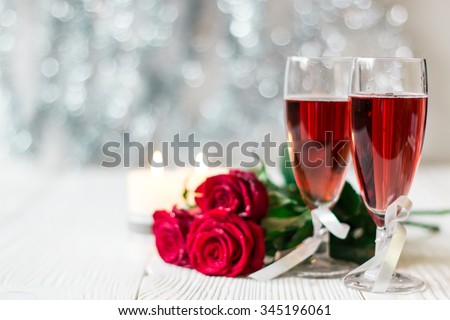 Romantic still life with pink champagne and beautiful red roses. Valentine's day concept.Soft focus - stock photo