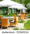 Romantic summer outdoor cafe terrace - stock photo