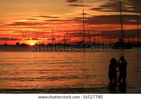 Romantic sunset at Nai Han beach, Phuket, Andaman Sea, Thailand - stock photo