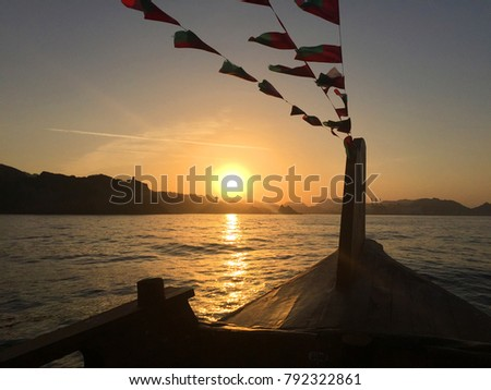 Romantic Sunset Cruise on a traditional wooden Dhow boat in Muscat, Oman, Arabian peninsula