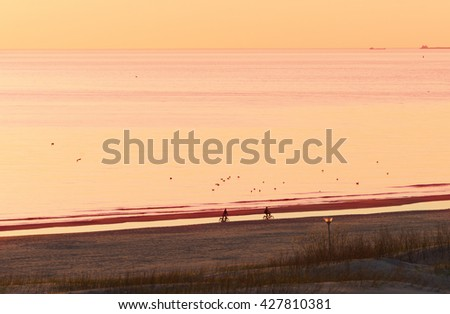 Romantic Sunset on the Baltic Sea in Ventspils, in Latvia. Ventspils a city in the Courland region of Latvia. Latvia is one of the Baltic countries - stock photo