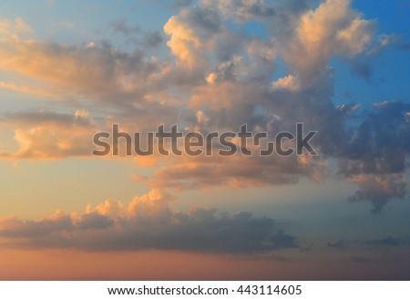 Romantic sunset sky. Beautiful fiery cumulus clouds before twilight - stock photo