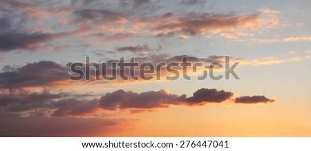 romantic sunset sky with illuminated clouds - stock photo