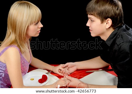 Romantic supper. Young the man proposal the offer to the girl - stock photo