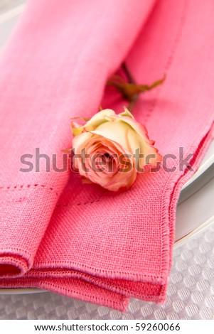 Romantic table settings. Arrangments with fresh roses and scented candles - stock photo