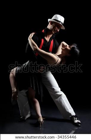romantic tango dancing couple on black
