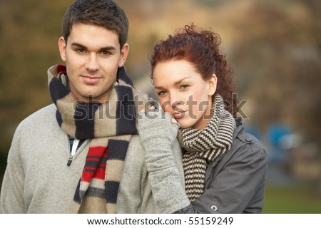 Romantic Teenage Couple In Autumn Landscape - stock photo