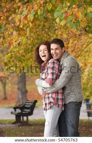 Romantic Teenage Couple In Autumn Park - stock photo