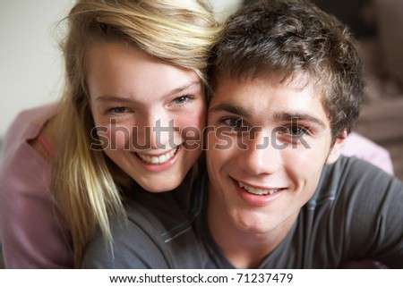 Romantic Teenage Couple Smiling At Camera - stock photo