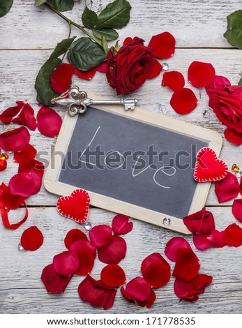 Romantic text handwritten on blackboard with chalk, valentines day  - stock photo