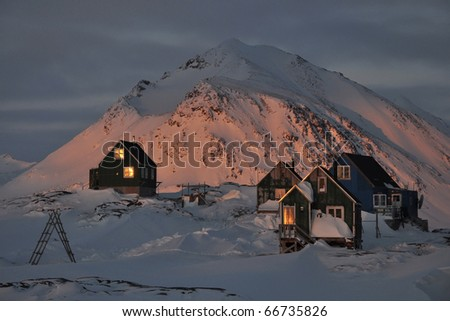 Romantic traditional houses in the evening light, Kulusuk village, Greenland - stock photo