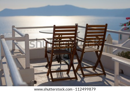 Romantic tranquil sunset view from the balcony of the hotel. Santorini island, Greece - stock photo