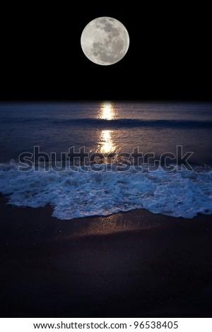 Romantic tropical beach with beautiful full moon - stock photo
