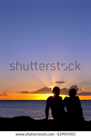 Romantic Vacation Image of a Loving Couple at Sunset With Copy Space