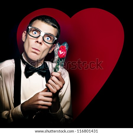 Romantic Valentines Day Nerd Holding Rose On Love Heart Background - stock photo