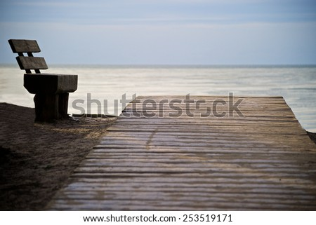 Romantic view from the bench to the Baltic sea  - stock photo
